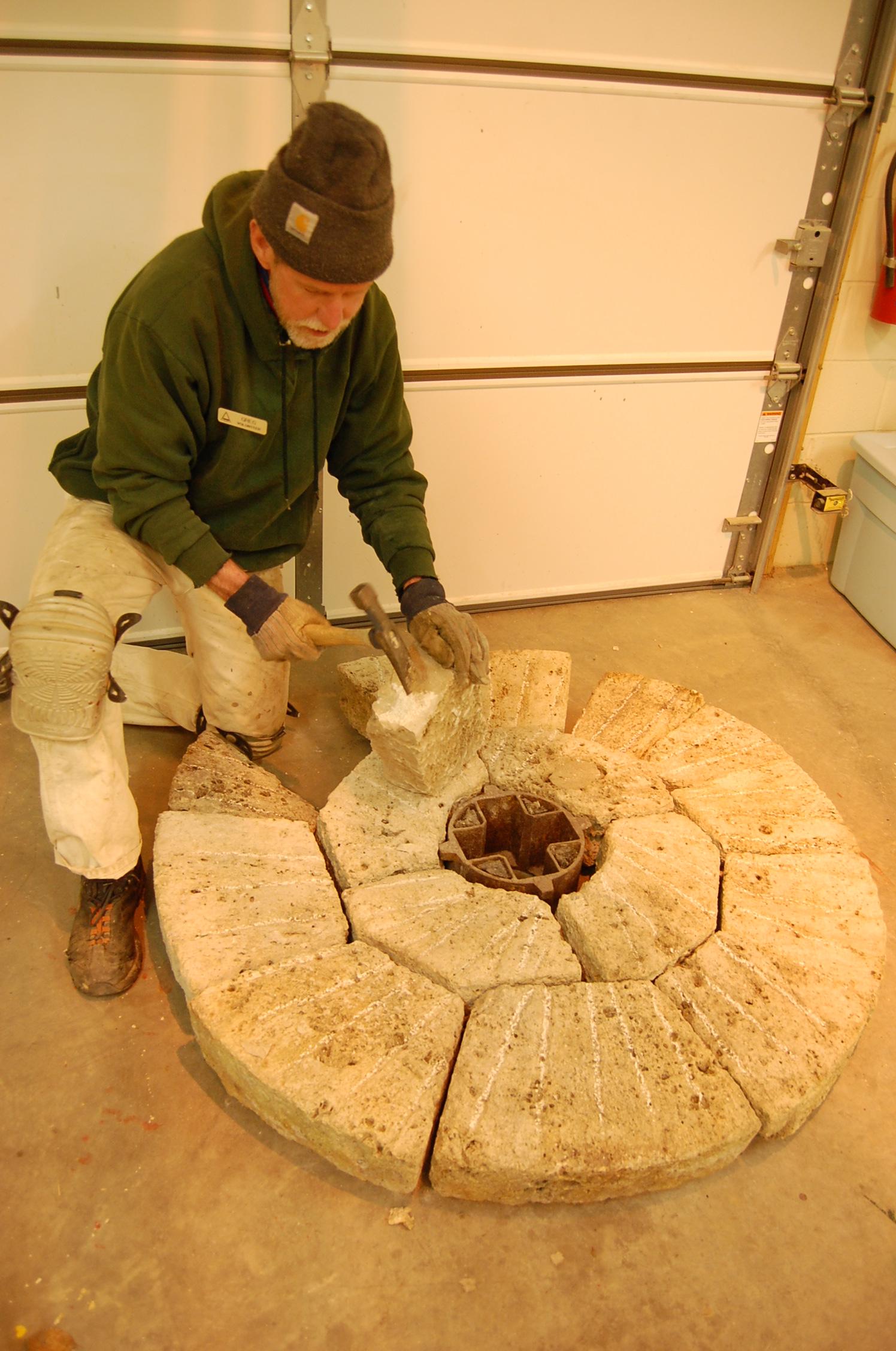 Volunteer Greg Voorhies reassembling the millstone pieces in 2013.