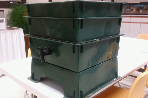 "Stackable worm bin, complete with spigot for ""worm tea"""
