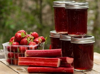 Fresh homemade strawberry rhubarb jelly with strawberries and rhubarb