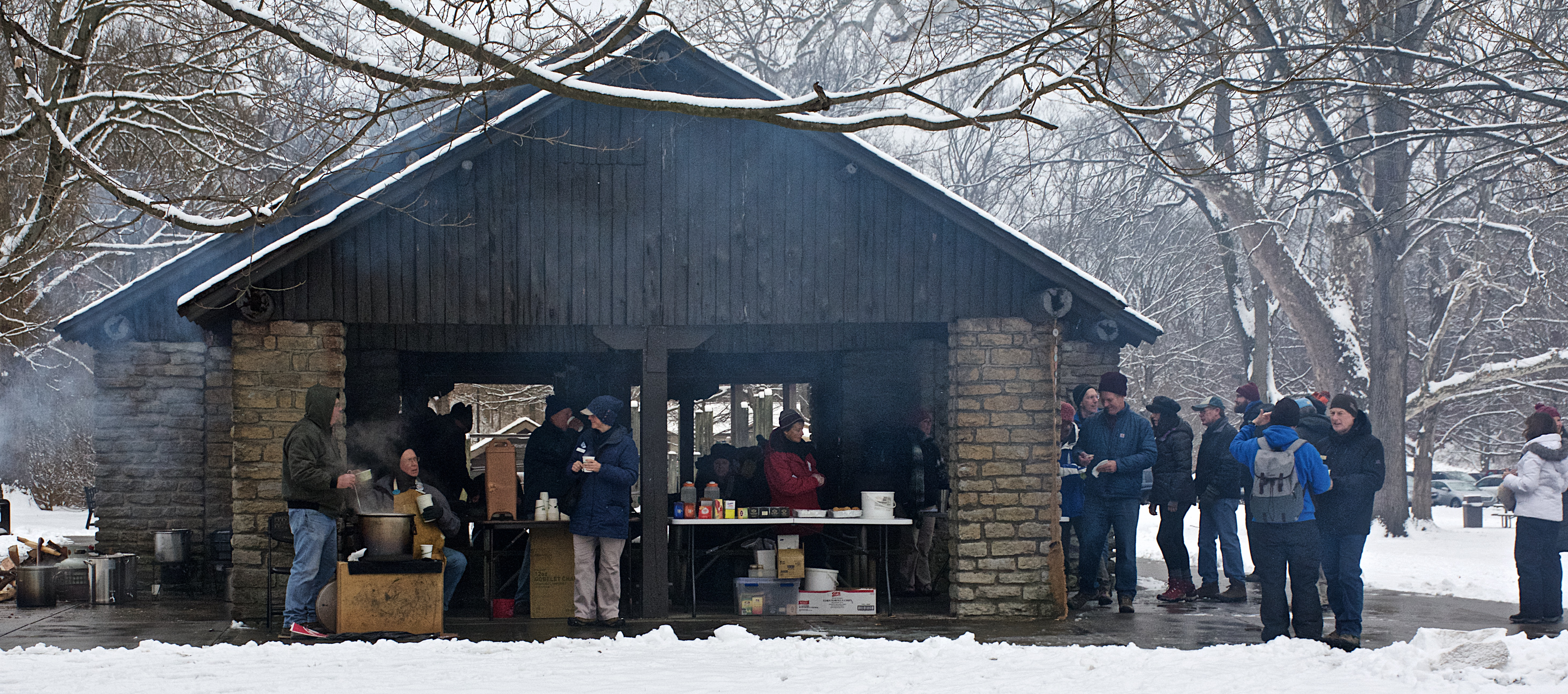 Park guests gather in a snow-covered Pavilion Grove Shelter after a long hike in January 2019.