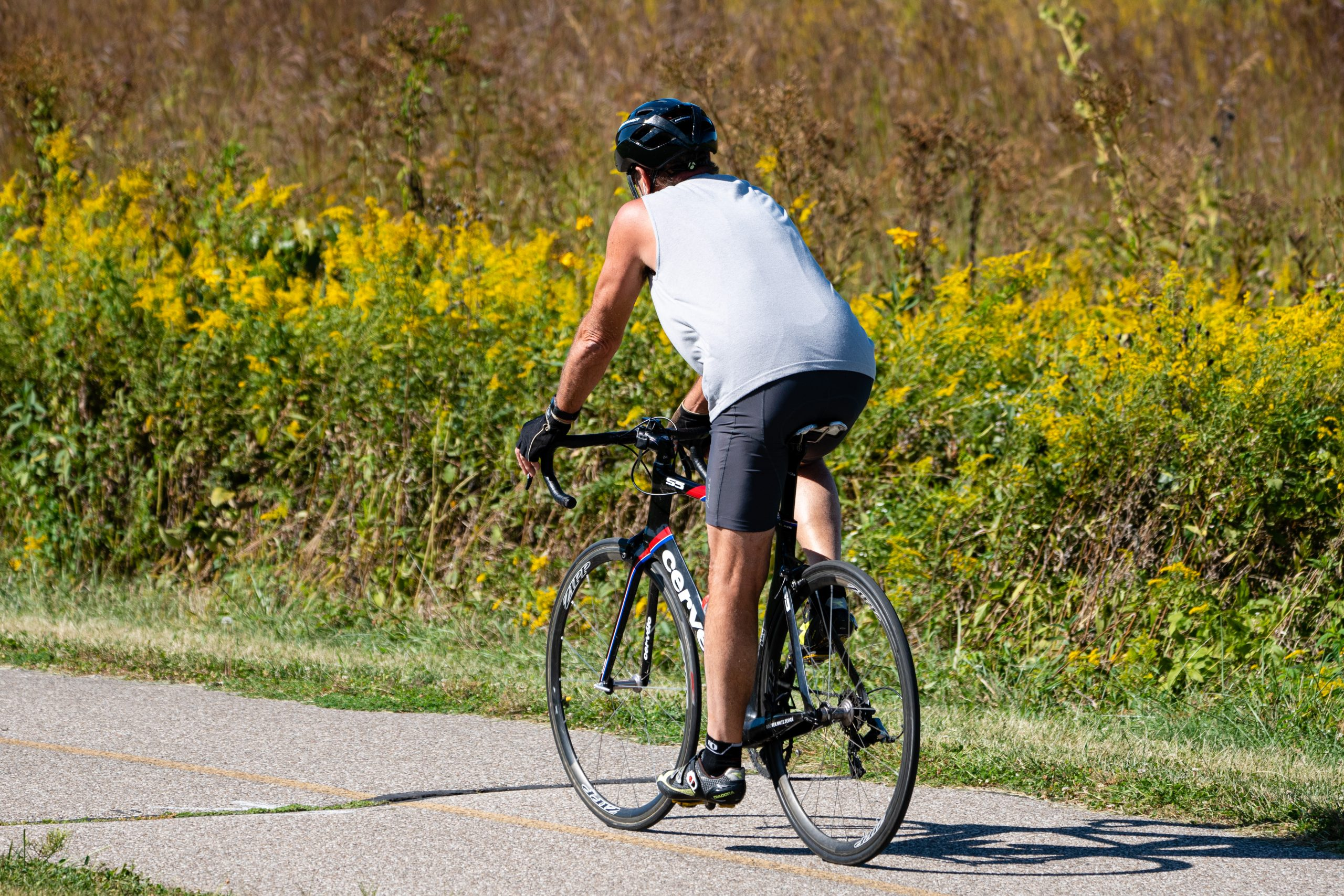 A man bikes on the Shaker Trace Trail at Miami Whitewater Forest on a sunny fall afternoon.