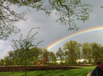 A rainbow shines over Glenwood Gardens on a rainy day.
