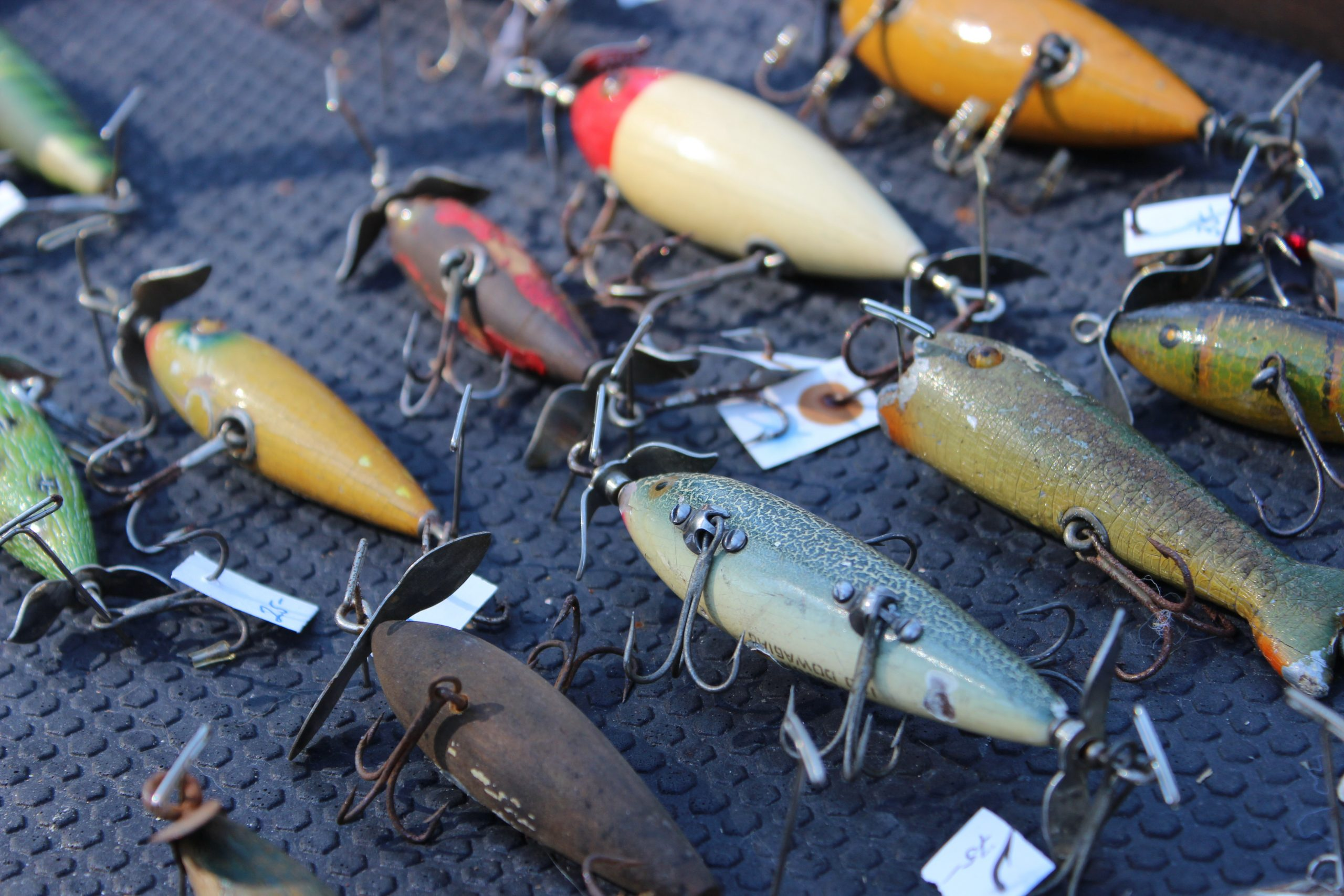 Brightly colored and pale fishing tackles