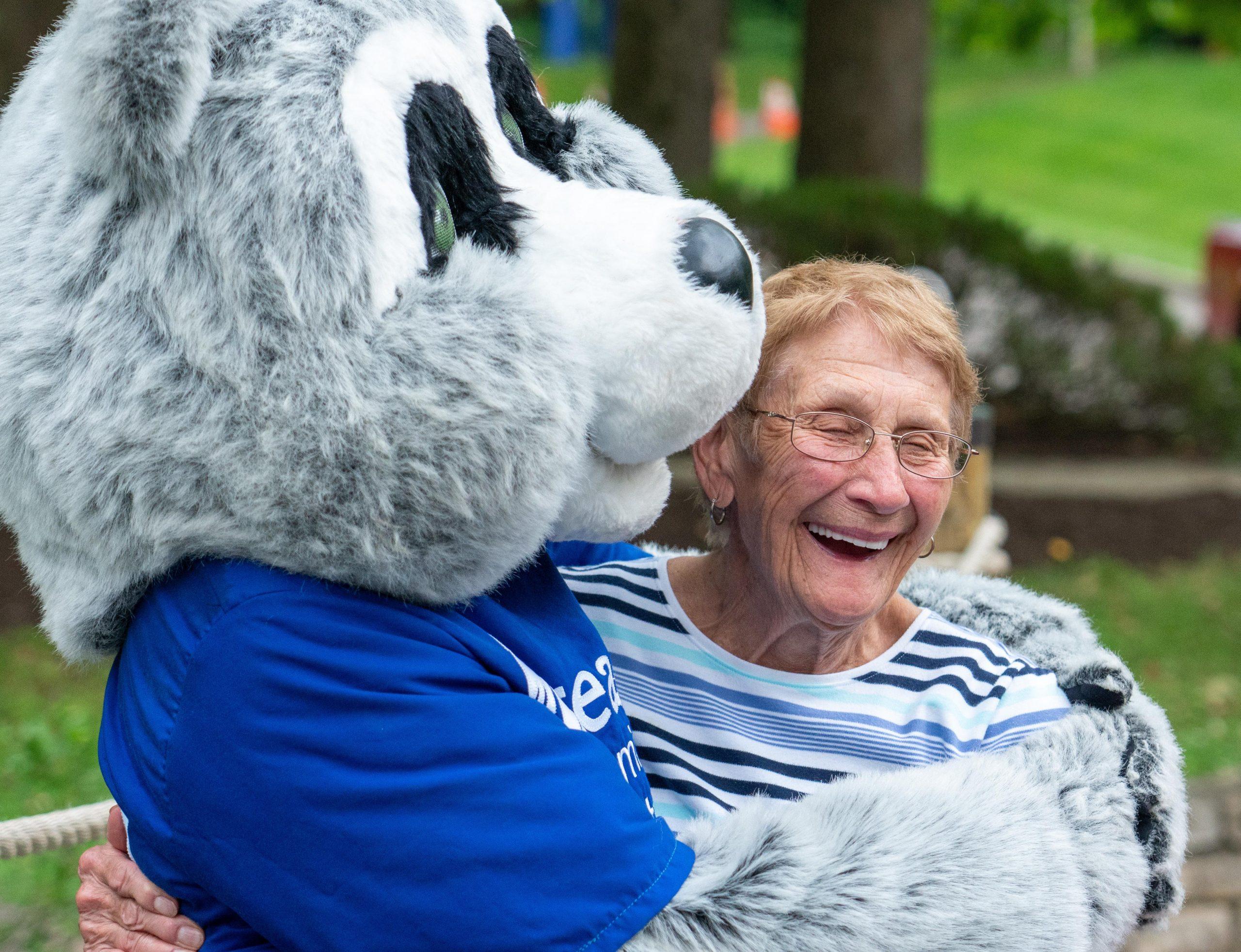 Parky the Raccoon hugs a guest at Lake Isabella.