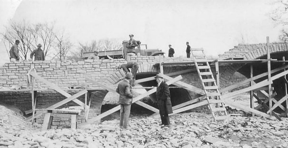 Construction of the Stone Arch Bridge that created the Kreis Dam and Sharon Lake.