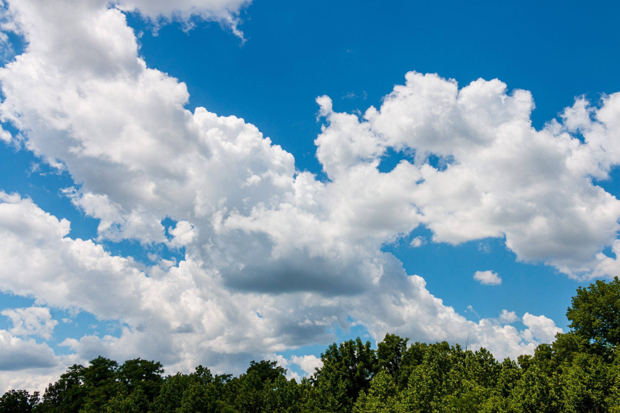 Clouds against a bright blue sky on a sunny summer day at Adventure Outpost in Winton Woods.