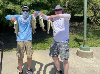 Anglers pose with their catch after the August 8 Bass Series tournament at Winton Woods.