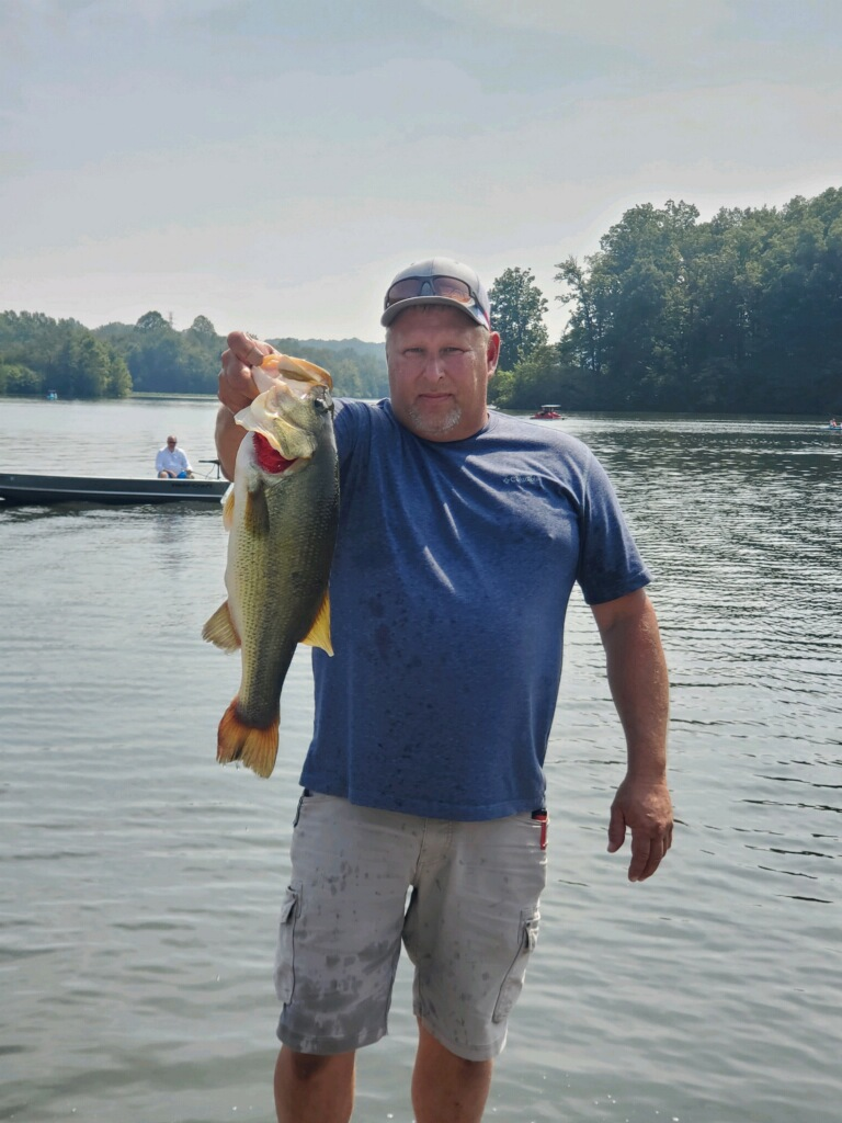 Mike Toht poses with one of his largest catches during the 2020 Bass Series Tournament season.
