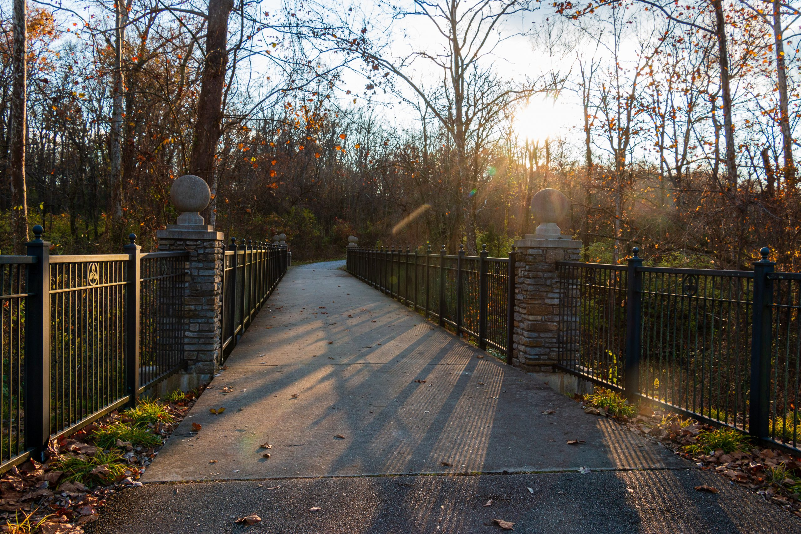 A stone bridge allows guests to cross a creek on the Garden Loop Trail at Glenwood Gardens.