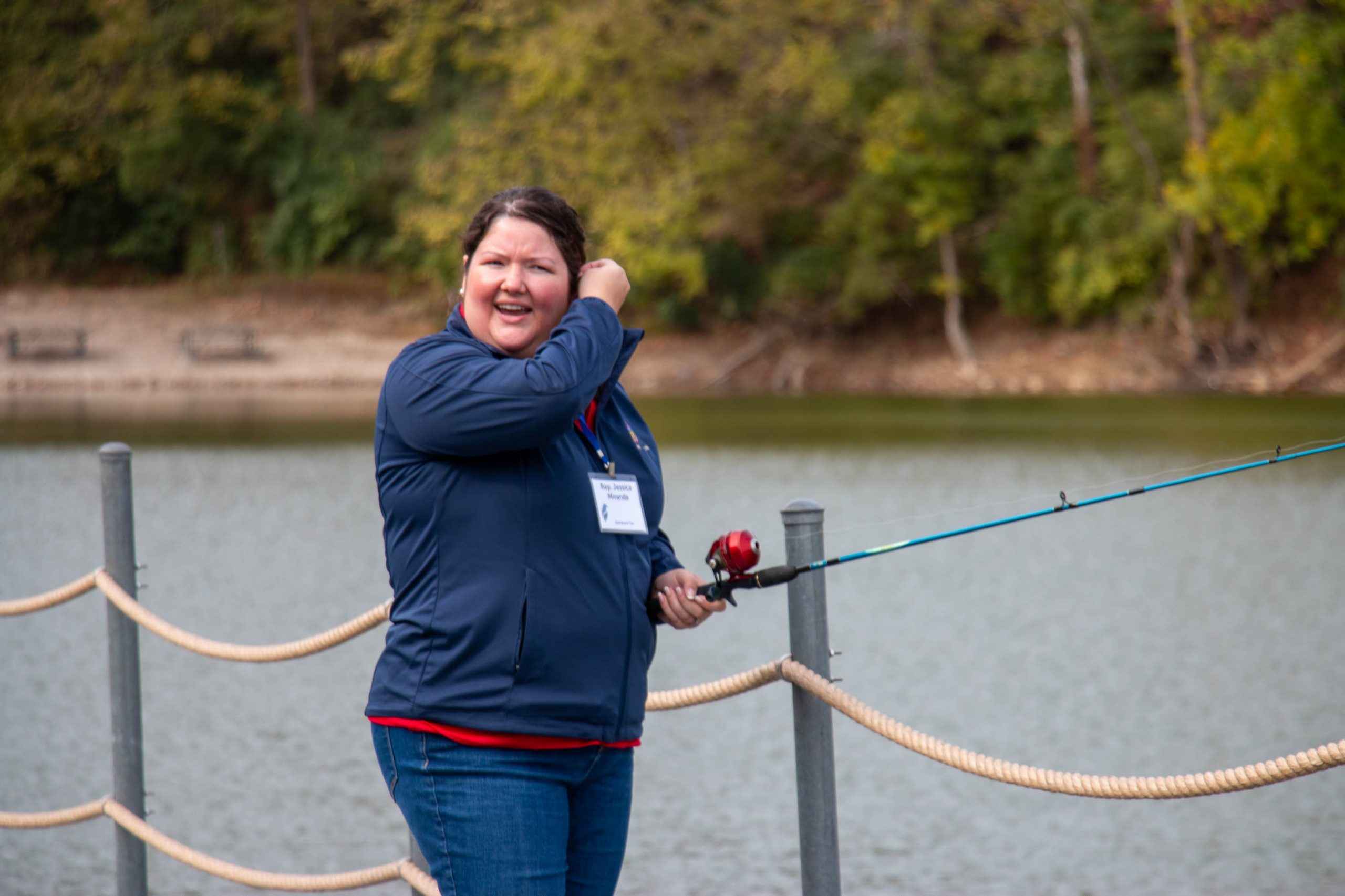 A woman smiles as she casts a line at Lake Isabella.