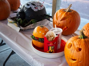 Several carved pumpkins line a table for the jack-o'-lantern contest at the 2018 Creepy Campouts.